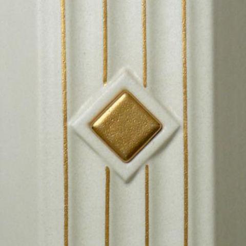 Bild: Lisene 122 Glasur 1100 gold dekoriert mit Einleger